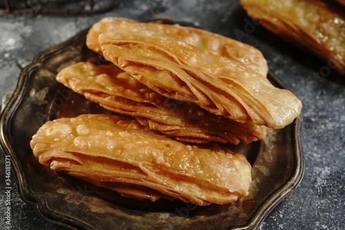 Fototapeta Homemade Indian sweet khaja /chirote or Madakku san, selective focus