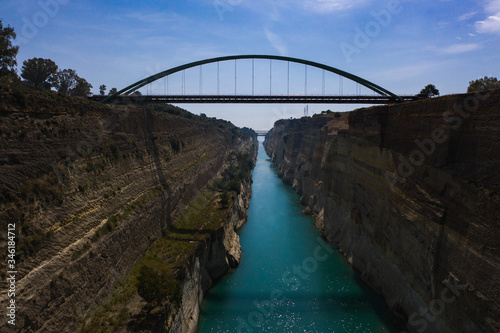 Fototapeta The Corinth Canal aerial view with bridge and traffic line