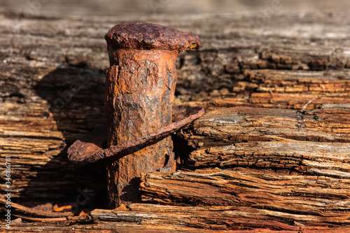 Valokuva A rusted spike extends from the weathered remnant keel of the Great Lakes schoon