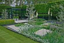 A Cool Modern Garden With Some Scandinavian Style And Soft White Planting