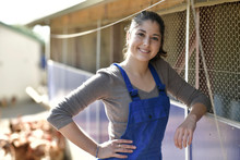 Smiling Young Farmer Standing In Poultry Yard