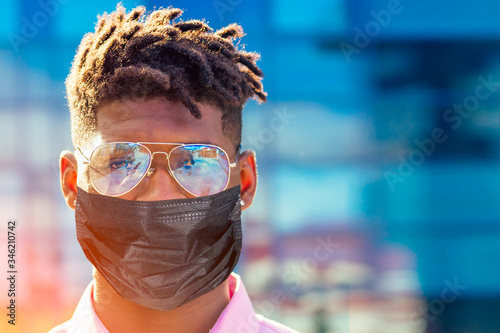 Fotomural portrait stylish and handsome African student American man with cool dreadlocks