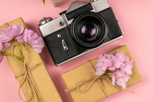 Camera, Gift And A Beautiful Purple Lilac. Month - May, June And July. Top Views, Close-up
