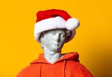 Teen Sculpture In Orange Hoodie And Christmas Hat