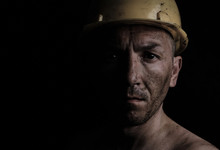 Miner In A Yellow Hard Hat On ...