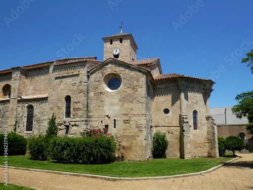 Photo Romanesque Church of Saint Jacques with original polygonal apse on the right