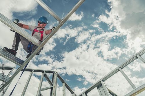 Construction Worker Attaches Pieces In Aluminum Structure. Canvas Print