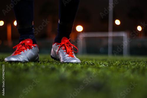 Photo Pies de futbolista en cancha