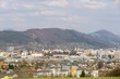 Sunrise and sunset, beautiful clouds over the meadow, hills and buildings in the town. Slovakia