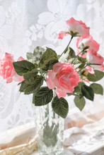 Delicate Roses On A Windowsill In A Vase
