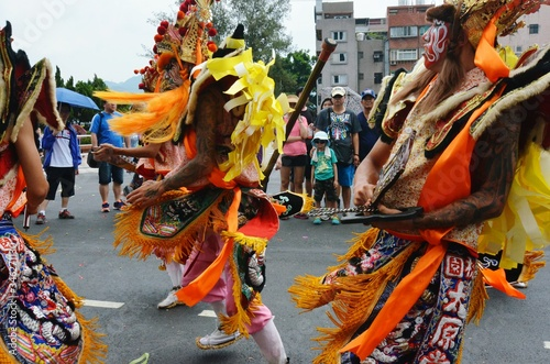 People Dressed In Costume Dancing On Street During Traditional Festival Canvas Print