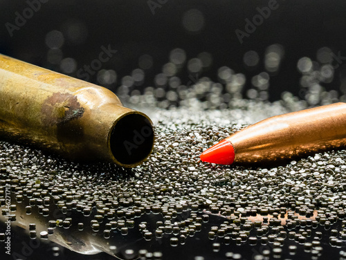 .223 5.56 caliber bullet, casing and gun powder close-up. Wallpaper Mural
