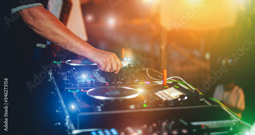 Fototapeta Dj mixing outdoor while streaming a online party festival concert during Coronavirus time - Alternative fest on isolation quarantine - Soft focus on hand - Fun, tech and people entertainment concept obraz