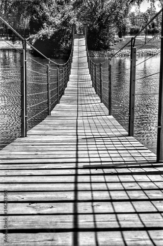 Canvas Print Footbridge Over River On Sunny Day
