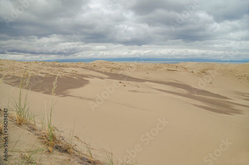 Dramatic clouds over the sand dunes at morning Canvas Print