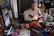 Elderly Woman Sewing Cloth Fac...