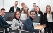 group of successful young employees in the workplace in the office