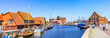 Leinwandbild Motiv Panoramic View Of Buildings And Canal In City Against Clear Blue Sky