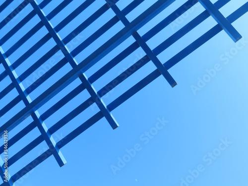 Fotografia pergola detail against blue sky