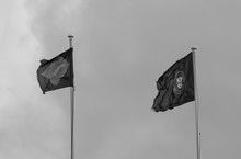 Low Angle View Of Brazilian And Portuguese Flags Against Sky