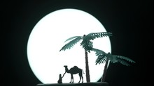 Miniature Toys - Low Key Silhouette Of Arab Man Sits Down Resting Or Praying With Full Moon And Palm Dates Trees In The Background.