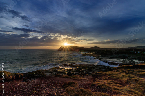 Foto Scenic View Of Sea Against Sky During Sunset