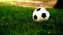 Close-up Of Soccer Ball On Grassy Area