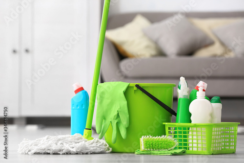 Fototapeta Set of cleaning supplies on floor in room obraz