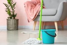Mop And Bucket On Floor In Room