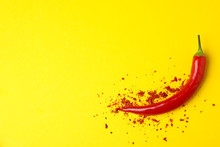 Tasty Chilli Pepper And Powder Spice On Yellow Background