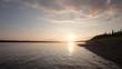 In the Siberian taiga a beautiful sunset on the river coast