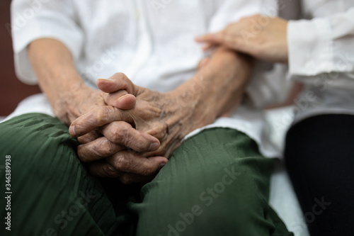 Fototapeta Old elderly patient hands clasped together because of excitement and nervousness,daughter holding touching her arm,care support encourage and empathy senior mother to be more confident at hospital obraz