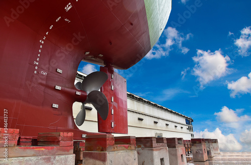 Fotografie, Obraz Detail stern and ship close up propeller, rudder red after maintenance already b