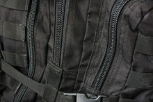 Clasps On A Black Tactical Bac...
