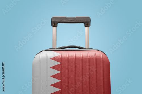 Photo Baggage with Bahrain flag print tourism and vacation concept.