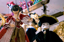 Low Angle View Of Puppets Hanging In Store