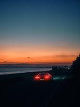 Car On The Beach At Sunset