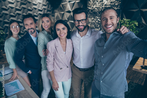 Fototapeta Work company development seminar is over. Positive smart business people marketers partners take selfie in office workstation wear striped white teal shirt suit blazer jacket tux tuxedo obraz