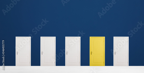 Photo Yellow door among white ones in room. Concept of choice