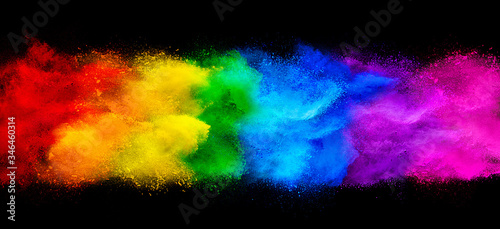 colorful rainbow holi paint color powder explosion garland banner isolated  dark black wide panorama background. peace rgb beautiful party concept