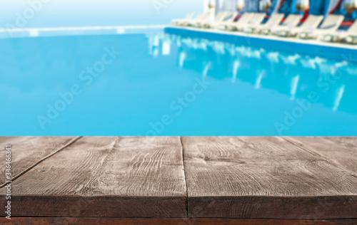Wooden deck near swimming pool outdoors on sunny day Fototapeta