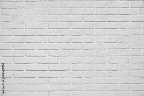 Fototapeta A white indoor brick wall abstract background or texture, new and clean, studio shoot obraz na płótnie