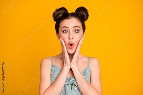 Vászonkép Portrait of astonished millennial girl hear wonderful bargain novelty impressed