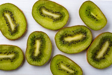 Kiwi Slices Laid Out On A Whit...