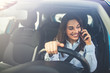 Woman In Car Talking On Mobile Phone Whilst Driving. Attractive woman uses smart phone while driving. Beautiful female Driver talking on the Phone.
