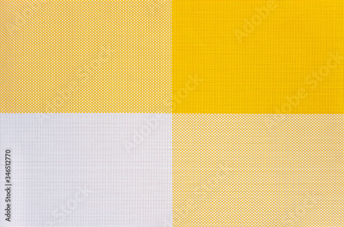 Yellow and white symmetrical background from perforated squares Canvas Print