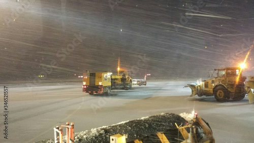 Cleaning Vehicles On Airport Runway In Blizzard Wallpaper Mural