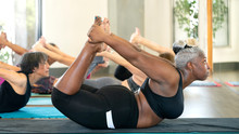 Woman Doing Bow Yoga Pose In A...