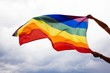 Leinwanddruck Bild - LGBT flag blown in the wind. Freedom and love concept. Pride month in June.