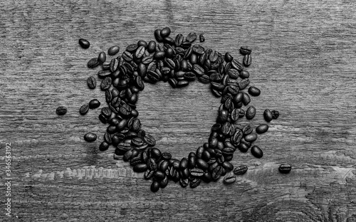 Group of arabica coffee beans with hearth shape on center, on vintage old wooden background Canvas Print
